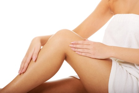 depilation: Well groomed female legs after depilation. Stock Photo