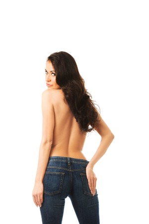 topless jeans: Topless woman wearing jeans touching her buttock.