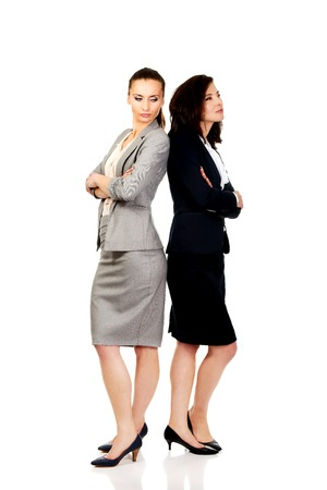 offended: Two offended businesswomen leaning on each other.