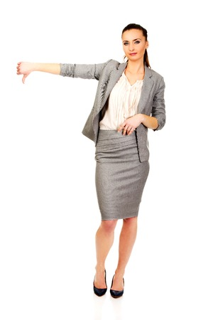 Modern business woman showing thumbs down. photo