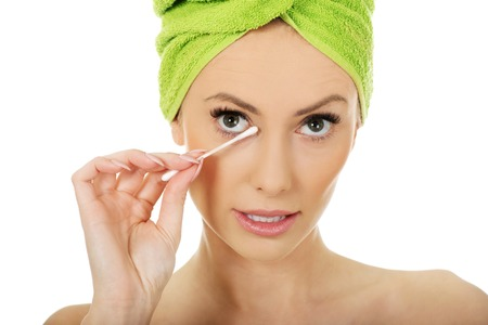removing make up: Beauty woman removing make up with cotton bud.