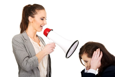 communication breakdown: Businesswoman screaming with megaphone on her friend.