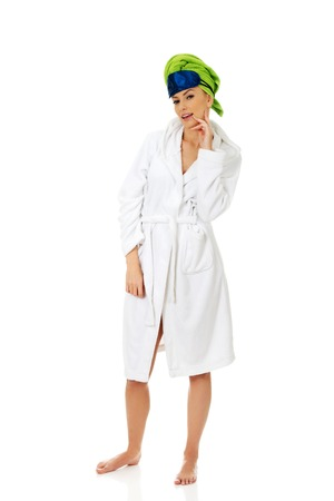 unsighted: Woman in bathrobe with sleep bandage. Stock Photo