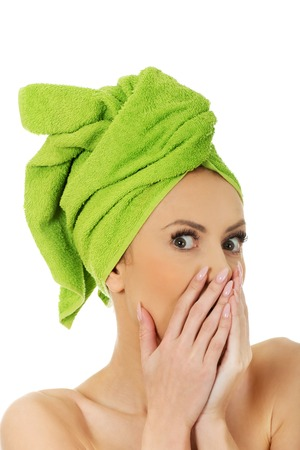 towel wrapped: Shocked woman with towel wrapped on head.