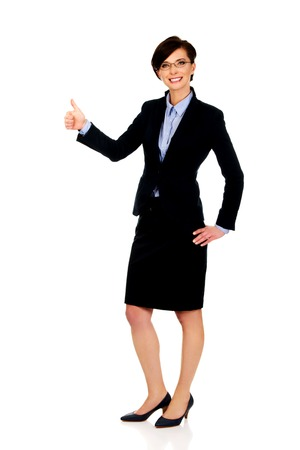 Happy smiling businesswoman with thumbs up gesture. photo