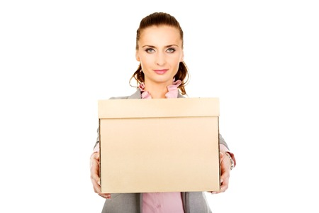 unemployed dismissed: Sad businesswoman carrying box after loosing job. Stock Photo