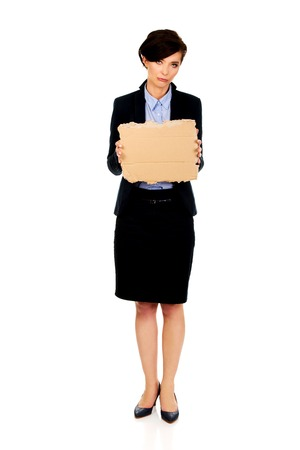 unemployed dismissed: Sad fired businesswoman with a cardboard. Stock Photo