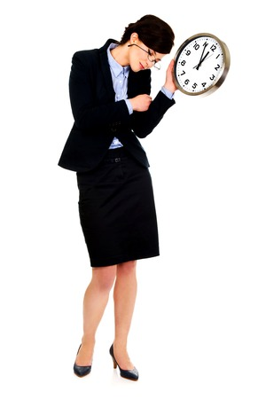 Exhausted business woman holding clock in hands. photo
