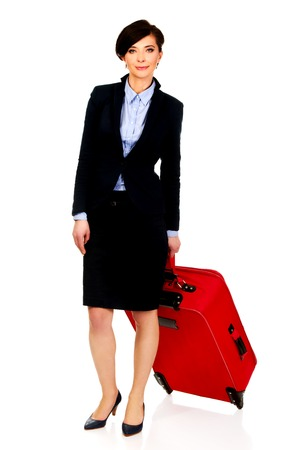 Happy smiling businesswoman with suitcase. photo