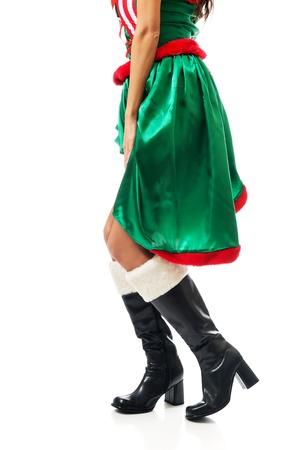 sexy xmas elf: Slim woman legs wearing elf boots.