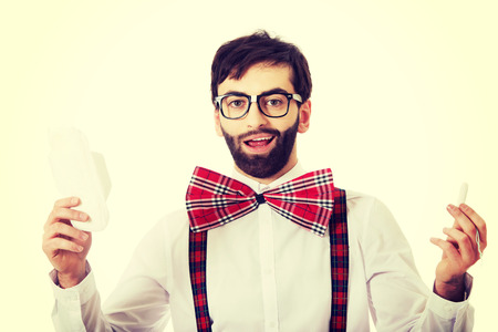 stereotypical: Handsome man wearing suspenders with menstruation pad.