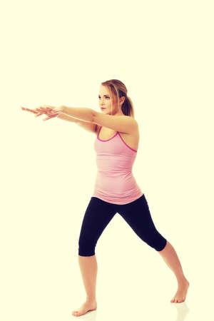 aerobic: Young active woman doing aerobic exercise. Stock Photo