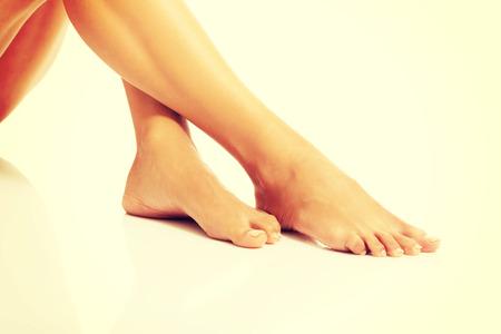feet naked: Womans beautiful bare feet on the floor.