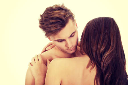 sex activity: Young beautiful caucasian couple embracing.