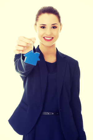 keychain: Smiling businesswoman holding a keychain