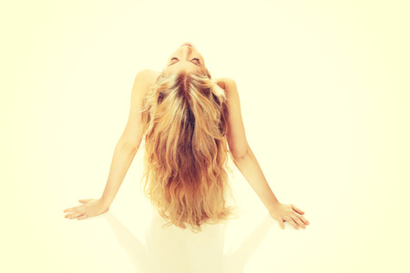 spreading arms: Blonde woman spreading arms on the floor. Stock Photo