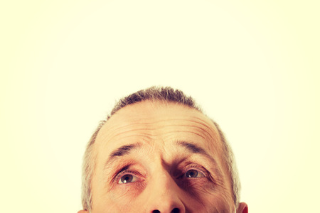 eyes looking up: Mature male eyes looking up. Stock Photo