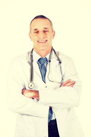 folded arms: Confident male doctor with folded arms. Stock Photo
