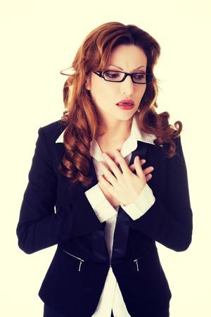 pangs: Sick businesswoman having heart disease.