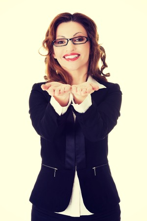 cupped: Happy smiling beautiful business woman with cupped hands. Stock Photo