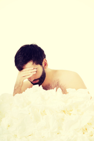 Tissues: Sick man with a lot of tissues.