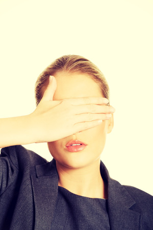 both: Blonde woman covering her face with both hands Stock Photo