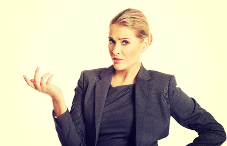 irritate: Confused woman showing irritate gesture.