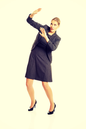 Businesswoman trying to protect herself. photo