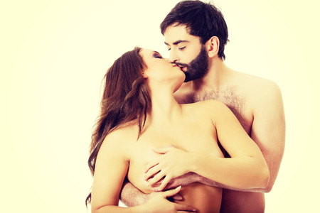 breast beauty: Handsome man touching womans breast and kissing her. Stock Photo