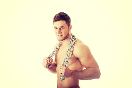 well build: Well build young male model with chains over his body.