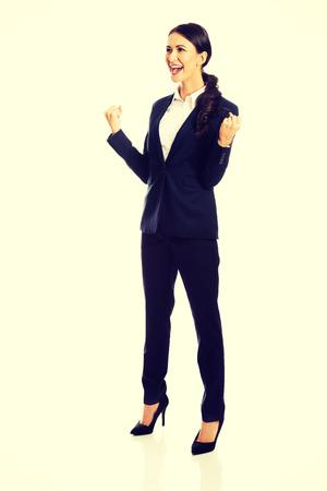 full length: Volledige lengte glimlachende vrolijke zakenvrouw
