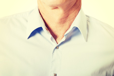 fully unbuttoned: Closeup on male shirt with collar. Stock Photo