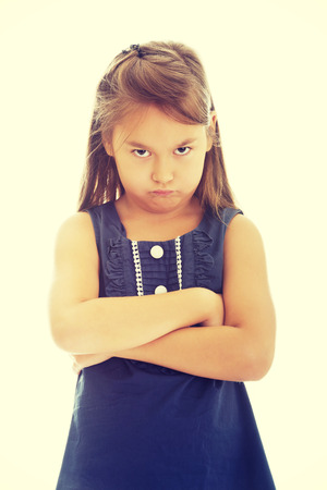 sad child: Angry and pride little girl Stock Photo