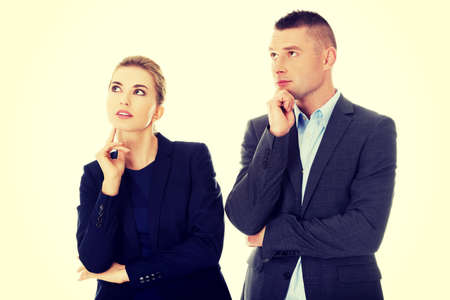 wondering: Businesspeople wondering about their corporation