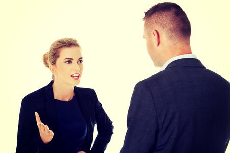 personas de pie: Empresarios hablando de su empresa