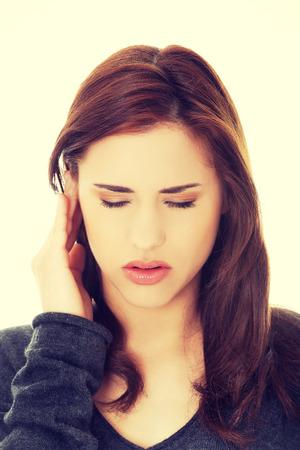 headache: Young brunette woman with a headache