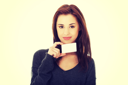 notecard: Casual happy woman showing business card Stock Photo