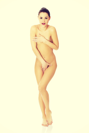 anatomy naked woman: Young slim woman covering herself