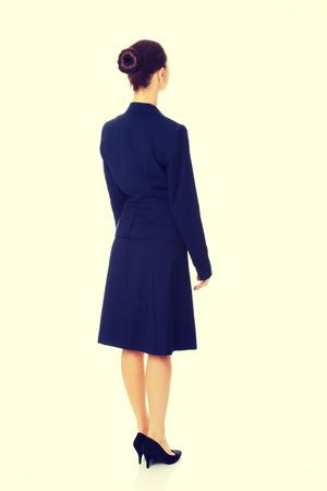 businesswoman standing: Businesswoman standing back to camera Stock Photo
