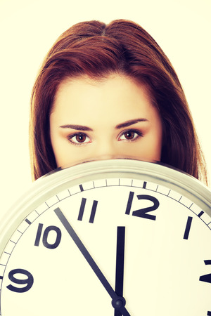 timezone: Young woman with clock. Time concept. Stock Photo
