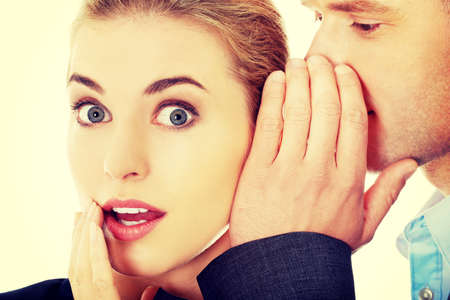 ears: Men whispering secret to his surprised friend Stock Photo