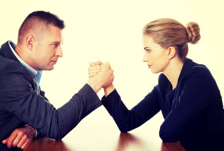 Young businesspeople fighting on hands photo