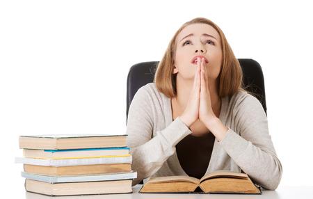 women praying: Woman praying to pass the exam.