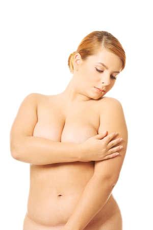 femme se deshabille: Femme en surpoids déshabillée couvrant lieux intimes Banque d'images