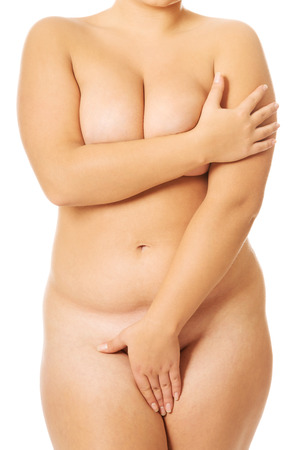 undressed: Undressed overweight woman covering intimate places