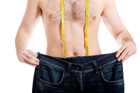 oversized: Man in dieting concept with oversized jeans. Stock Photo