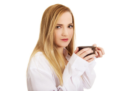 long sleeve shirt: Beautiful woman in long sleeve shirt drinking coffee.