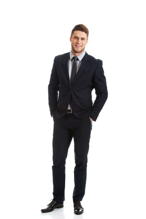 hands on pockets: Successful confident businessman with hands in pockets. Stock Photo