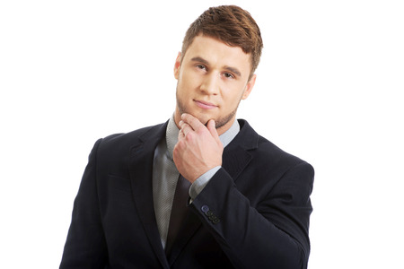 chin: Successful thoughtful businessman with finger under chin. Stock Photo