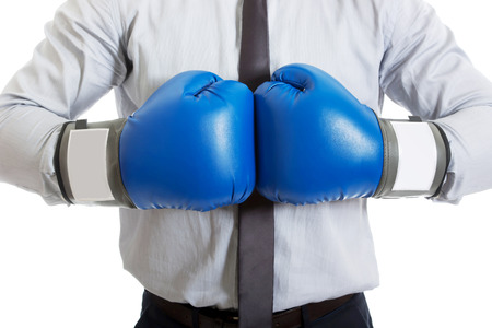 authoritative: Young businessman with boxing gloves. Stock Photo